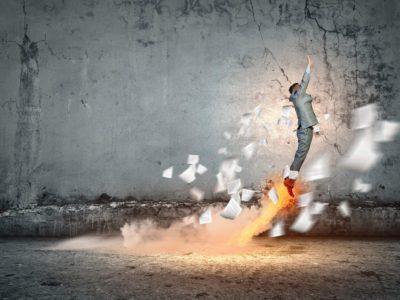 Image of young energetic businessman flying upwards